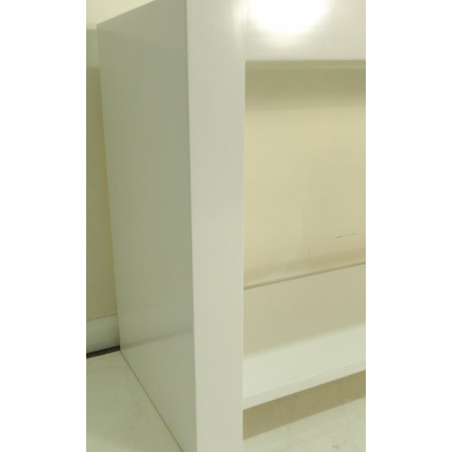 In a crisp new white lacquer finish is this modern / contemporary Console Table. The table is large and features a lower...