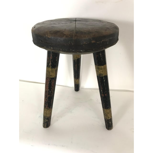 This is the most amazing one of a kind Swedish leather topped stool with black and gold striped legs. The leather top has...