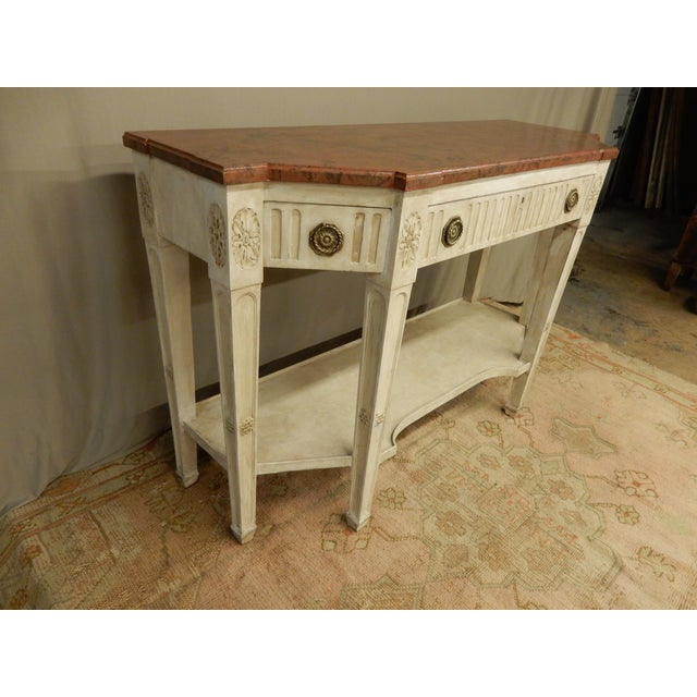 Early 19th century painted French Directoire' console. The console has 3 drawers and lower shelf and a faux marble top.