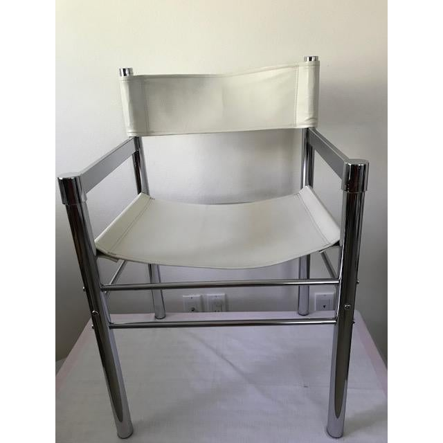 A set of 4 MOD 70's Tubular chrome and pleather chairs. All are in excellent condition for their age. The pleather is all...