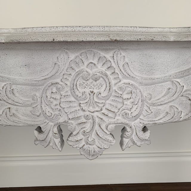 Gorgeous carved console table by Noir in a white wash finish. This stunning piece could work in so many different spaces,...