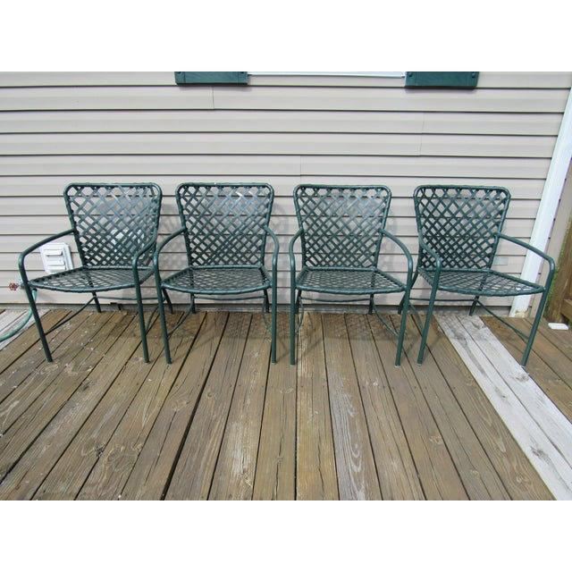 Up for offer here is a fine set of 4 vintage Mid Century Modern metal tube and vinyl strap Tamiami outdoor furniture...
