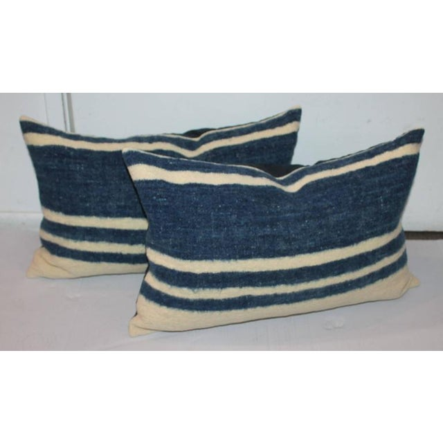 These hand woven Mexican weaving bolster pillows are in great condition. Sold in pairs. The backings are in blue cotton...