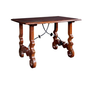 A Rustic Spanish Baroque Style Walnut Trestle Table With Iron Stretcher For Sale