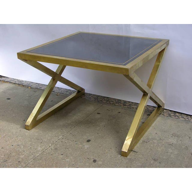 Pair of Italian Design side / sofa tables entirely hand-sculpted in bronze, high quality of execution with a streamlined...