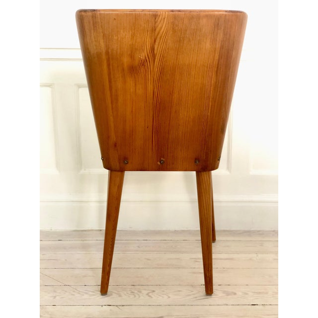 Set of 4 Goran Malmvall Swedish pine chairs, Svensk Fur, Sweden, 1940s Chairs have been structurally repaired for better...