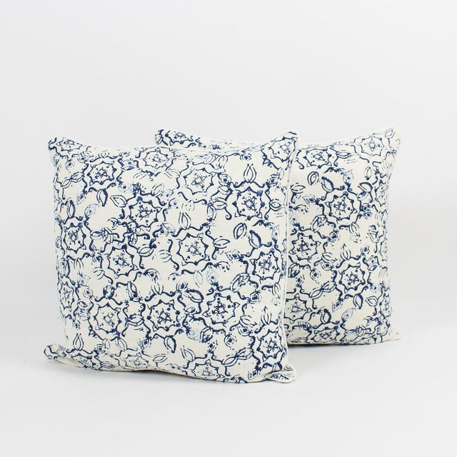 Pair of custom blue and ivory ink swirl pattern pillows. Pattern on fronts and backs, complemented with premium solid...
