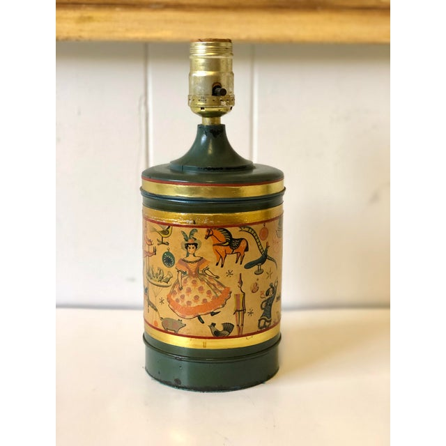 Charming early 20th Century children's petite dark green tole lamp with paper applique having darling Art Deco stylized...