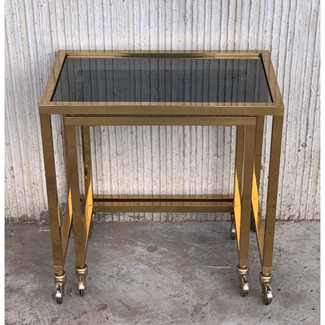 Metal Nesting Tables Italian Design 1970 in Brass With Smoked Glass and Wheels - a Pair For Sale - Image 7 of 11