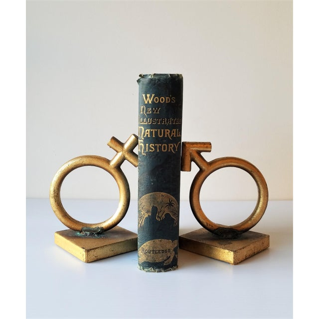 1970's signed C. Jere 'Sexes' bookends. Cast out of iron and painted gold have acquired a beautiful patina at their...