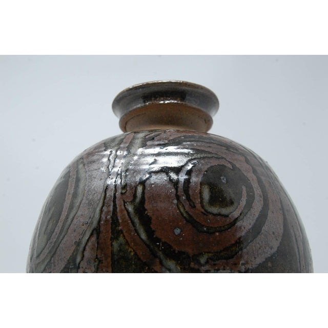Large bulbous studio pottery vase by New Hampshire master potter Gerry Williams. Executed, circa 1970s. Incised signature...