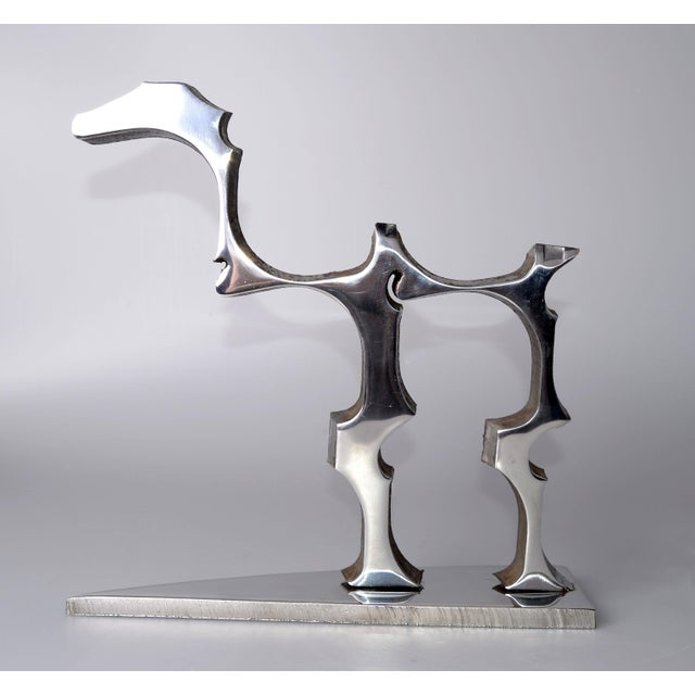 Amazing stainless steel table dinosaur sculpture. One of a kind craftsmanship with the Industrial Look. No signature.