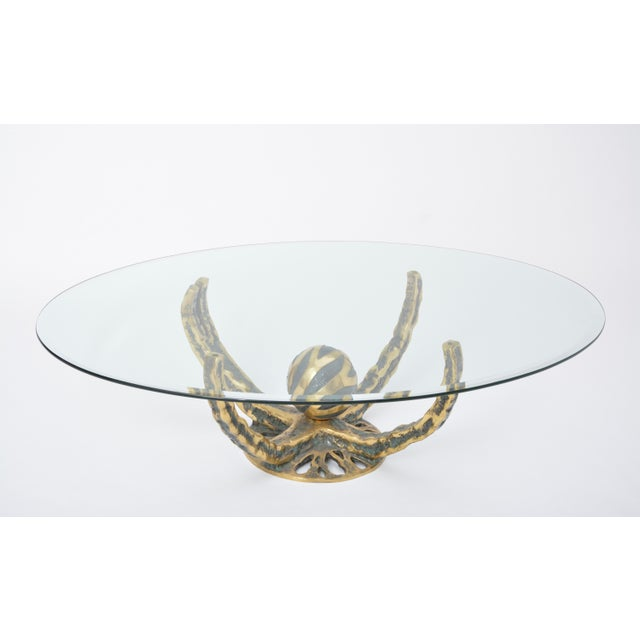 Spectacular coffee table made and designed by Henri Fernandez, France, 1972. This table has a solid bronze octopus shaped...