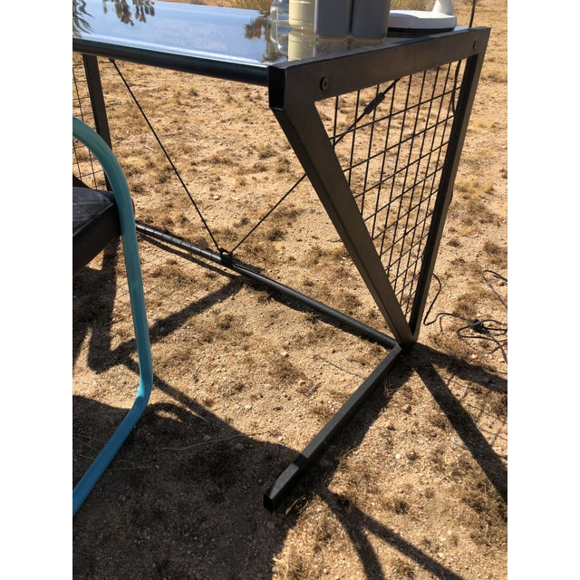 Really cool metal/glass desk with middle tension rods and grid pattern on side. No physical damage. Super cool.