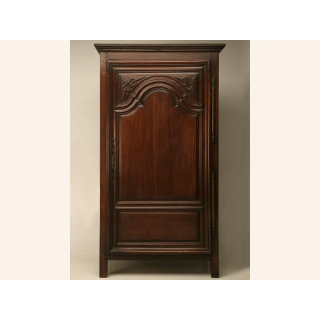 Outstanding antique French Louis XIV bonnetiere with echoes of the Louis XIII style. The door, which has two raised...