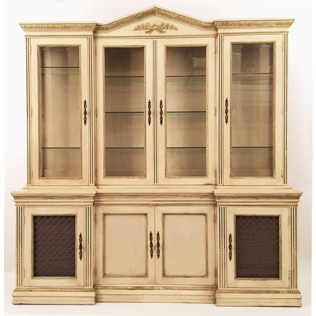 Monumental solid wood reverse breakfront hutch by Davis Cabinet Company features ornate pediment top, raised moldings and...