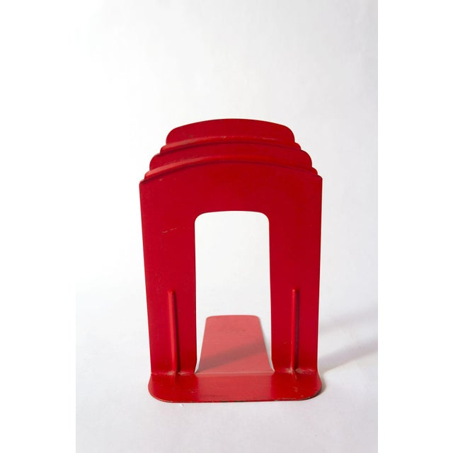 """Beautifully bold red bookends lend a slightly industrial feel in a cheery color. Each measures 6""""W x 7.5""""D x 9""""H"""