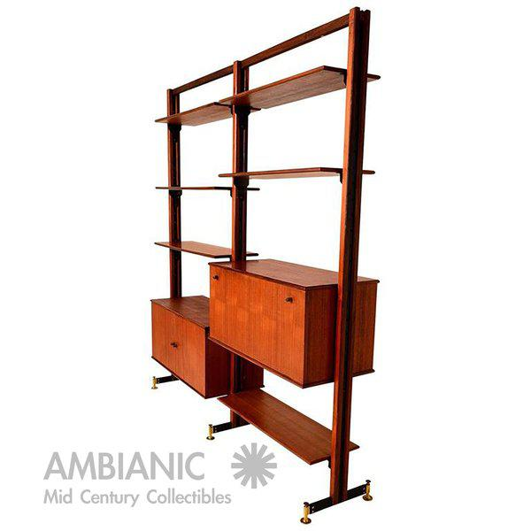 For your consideration a two bay free standing wall unit, which can serve as room divider. Beautiful wood grain unsure of...