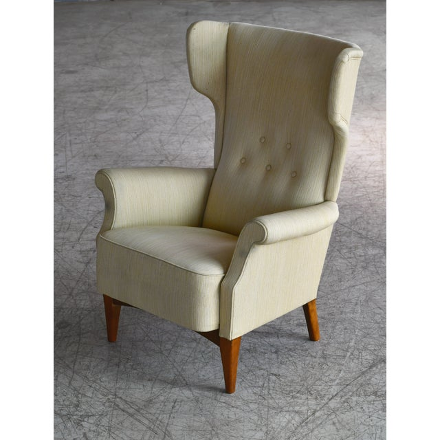 Fantastic Danish Mid-Century wingback chair model 8023 designed by Fritz Hansen and first seen in Fritz Hansen's 1951...