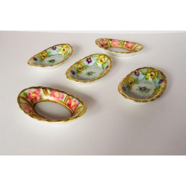 """Antique hand painted floral porcelain set of five salt and pepper dishes, no makers mark in excellent condition. 2.75""""L X..."""