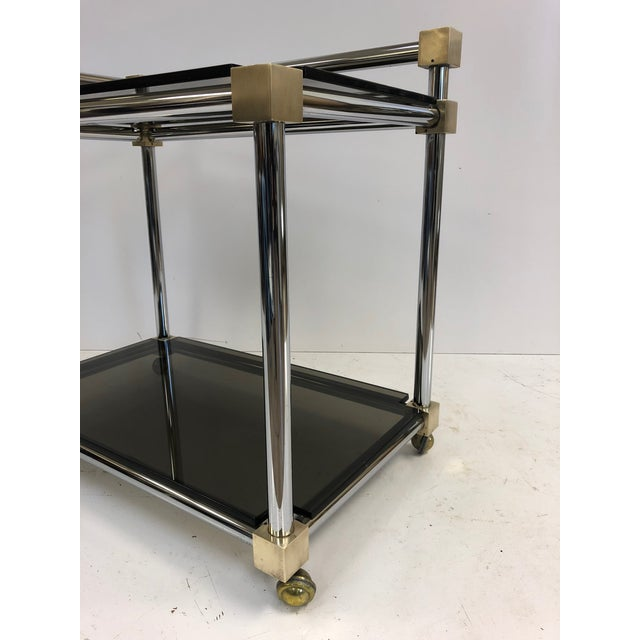 French Mid-Century Modern Two-Tier Brass, Chrome and Smoked Glass Bar Cart For Sale - Image 3 of 5