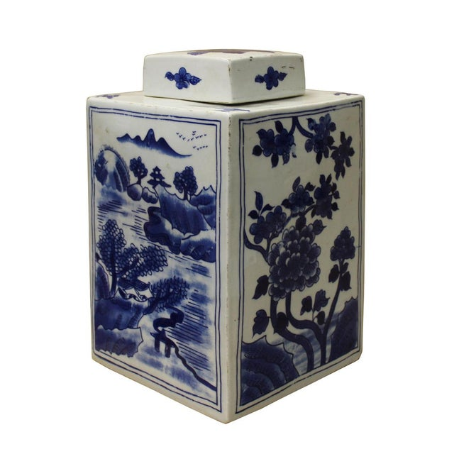 This is a traditional Chinese decorative porcelain jar in square shape blue & white color with flowers mountain scenery...