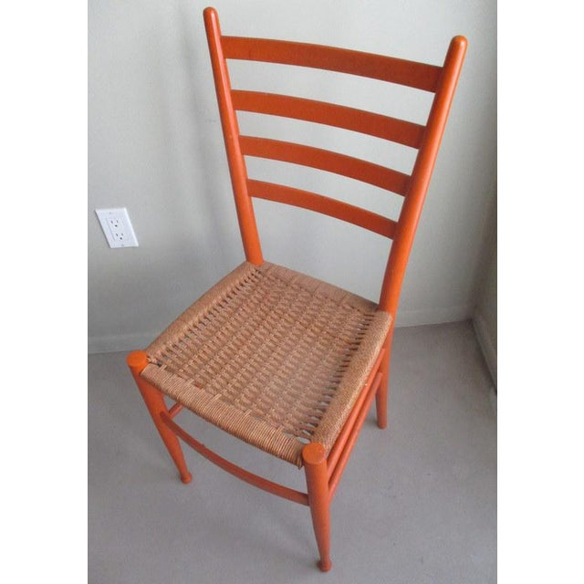 Original vintage mid-century modern Gio Ponti style side chair. Features original orange paint and rope seat. Great...