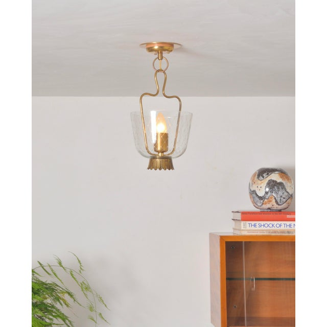 Overly adorable minuscule pendant which can double as a flush mount when used as shown. Brass structure with etched glass...