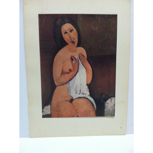 """This is a Mounted French Color Print that is titled """"Nu Assis A La Chemise"""" by Modigliani. The Print is dated Paris 1947..."""