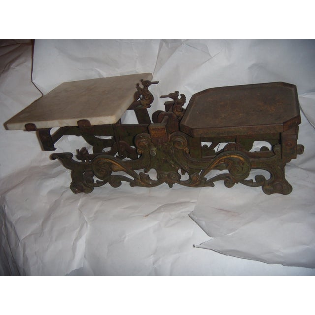 A Victorian cast iron scale with a marble plate and four kilo weights, I was told made in Germany . Great decorative...