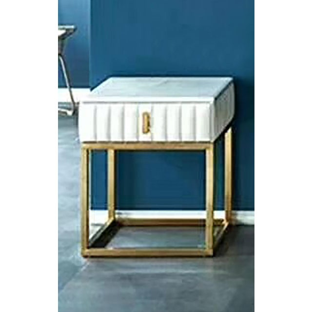This stylish contemporary side table features an elaborate striped upholstery and gold metal legs. A genuine white marble...