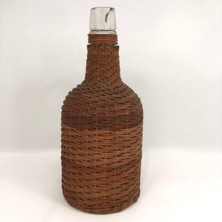 Early 20th Century Wicker Covered Demijohn With Handle Preview