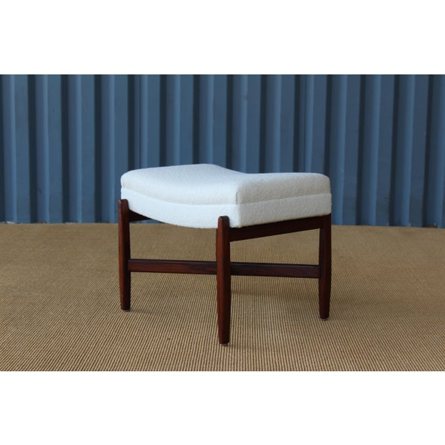 Rosewood footstool with new Knoll bouclé upholstery. Rosewood has been recently refinished.