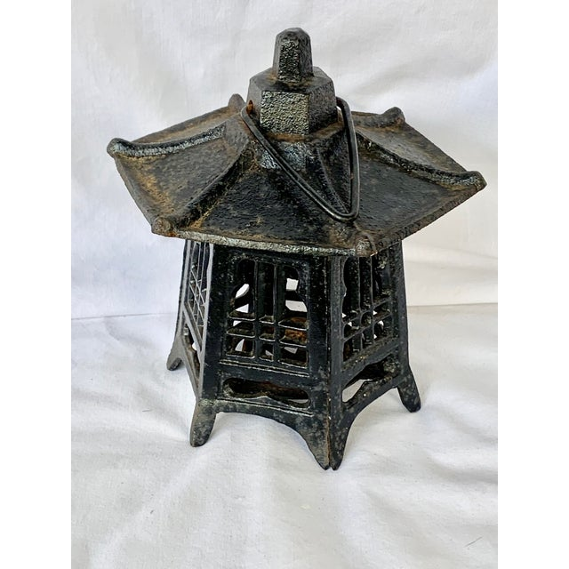 Wonderful vintage pagoda lantern. Made of cast iron. Use it indoors or outdoors to give any space a warm glow. This is a...
