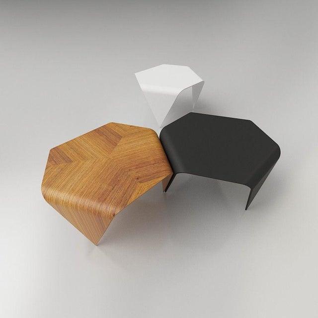 Authentic trienna table with oak veneer by Ilmari Tapiovaara & Artek. This incredibly distinctive table is formed from...