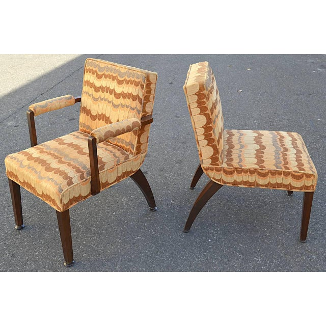 A wonderful set of two arm and four side chairs. Gilbert Rohde for Herman Miller 1939, fabric redone in the 1970s. The arm...