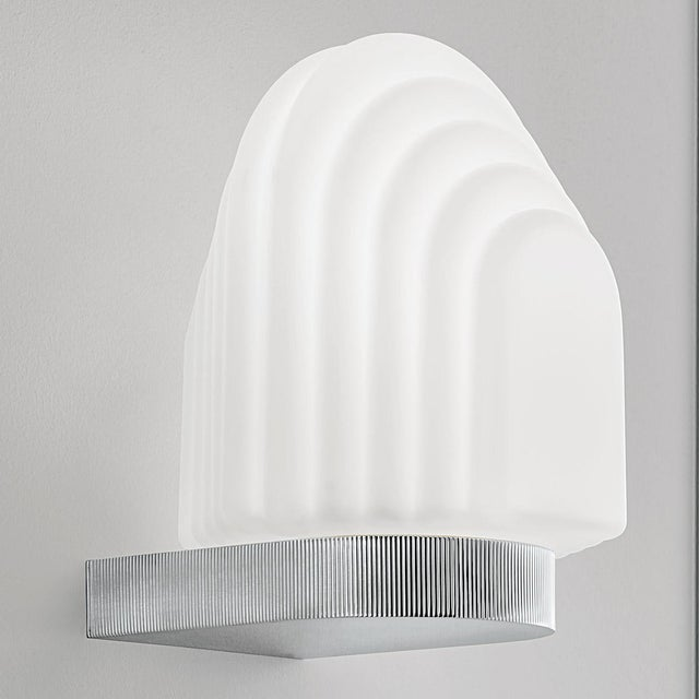 An art deco style bathroom wall light in polished chrome with mouthblown glass. Certification: IP44 (zone 2). We recommend...