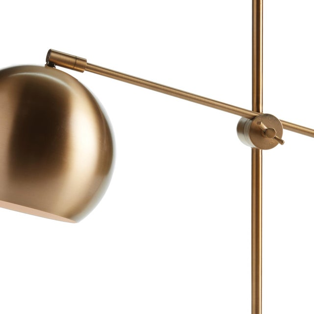 With a dually adjustable design, the Graydon Desk Lamp is modern architecture for the room. The brass finish and marble...