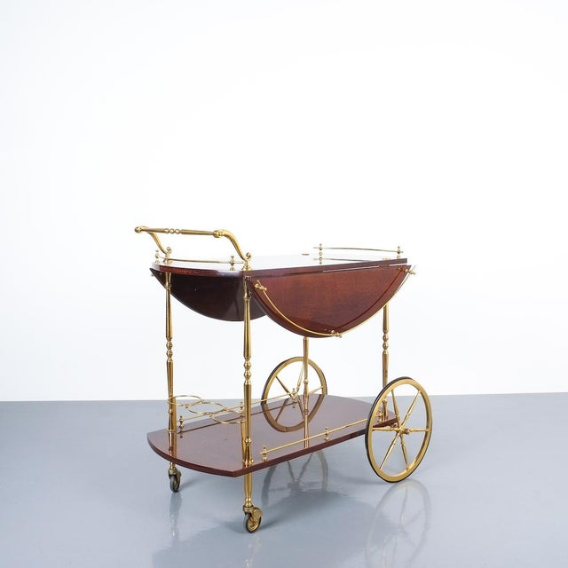 Aldo Tura adjustable brown parchment brass bar cart, 1960. Large adjustable bar cart table, it's composed of two dyed...