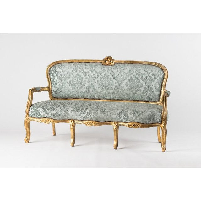 Beautiful light mint Adalie sofa with floral velvet textured fabric. Sofa has gold trim edging.