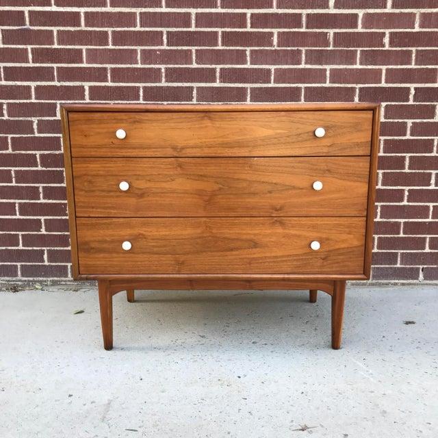 Vintage Mid Century Modern Drexel Declaration Walnut Highboy Dresser. It features gorgeous walnut grain and three exterior...