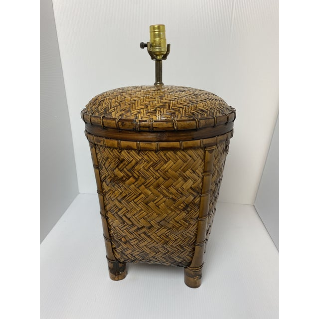 A beautiful blend of light and dark wood colors come together to create a natural look in this vintage rattan table lamp....