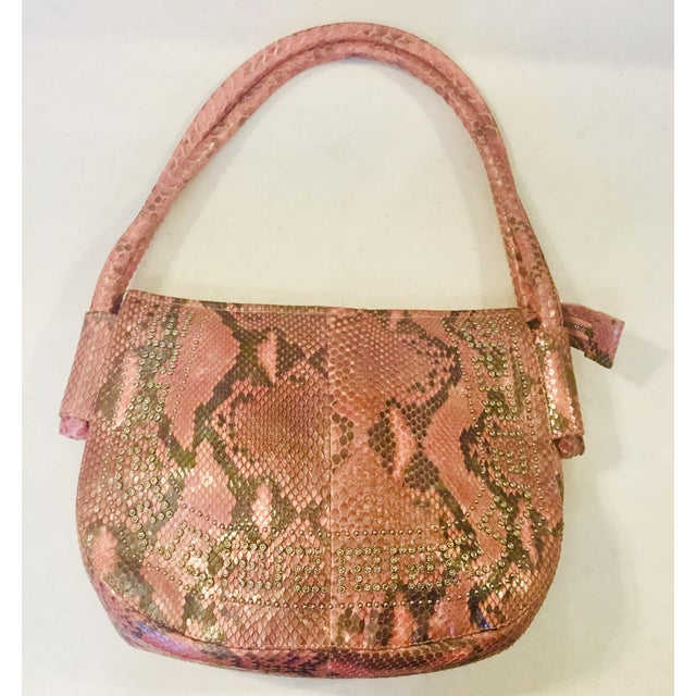 Rare early '90s purse from the iconic designer, Gianni Versace. Supple iridescent pink python skin, double straps,...