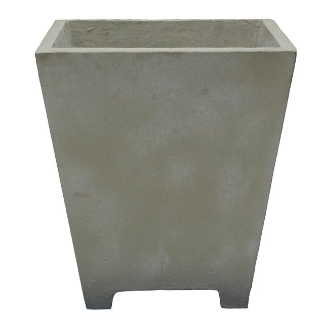 Our modern cast cement planter features a tapered sides, a 4 legged base and natural finish. Simple in design the generous...
