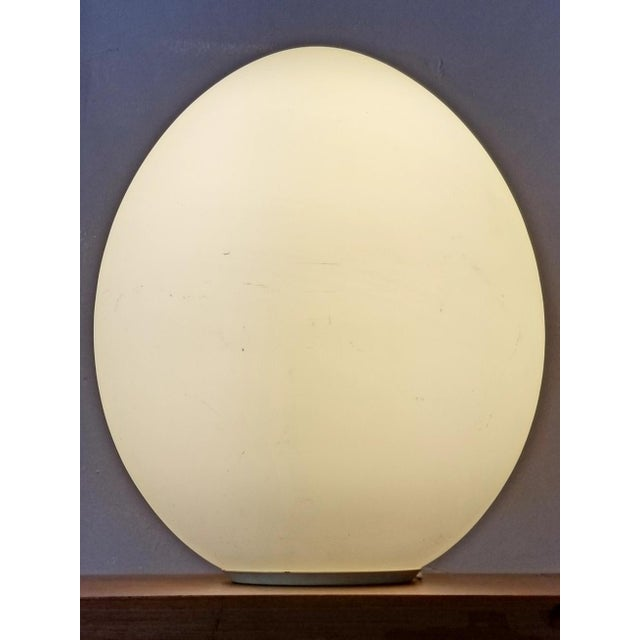 Stunning Italian mid-century frosted glass egg lamp. It has a switch for the power it on and off and a metal base where it...