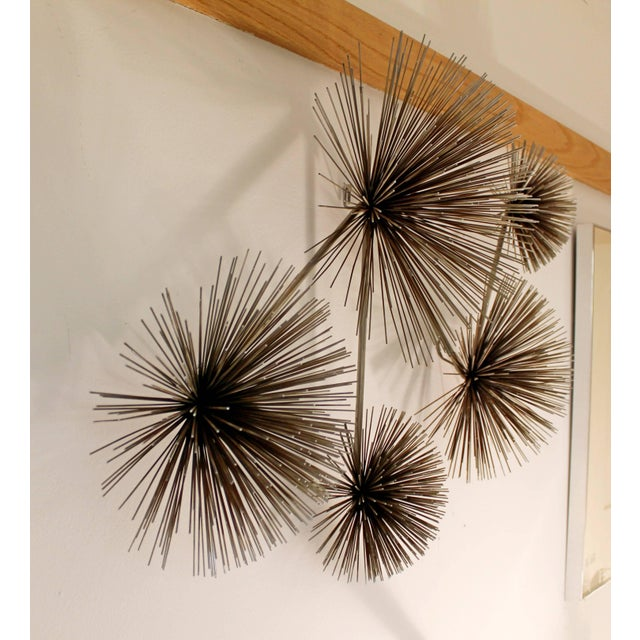 For your consideration is a classic, brass pom pom hanging wall sculpture, designed and signed by Curtis Jere. In...