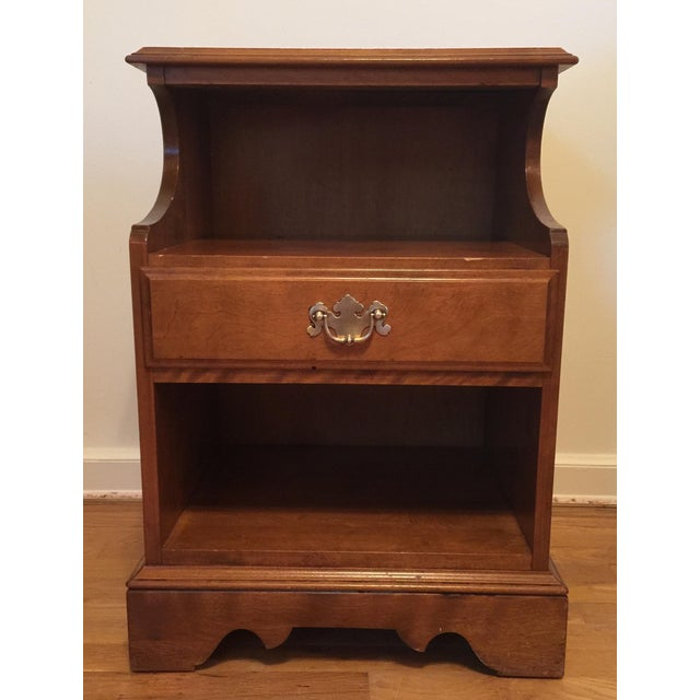 Solid maple wood nightstand from Ethan Allen by Baumritter. This vintage, circa 1950s piece, has a single drawer and two...