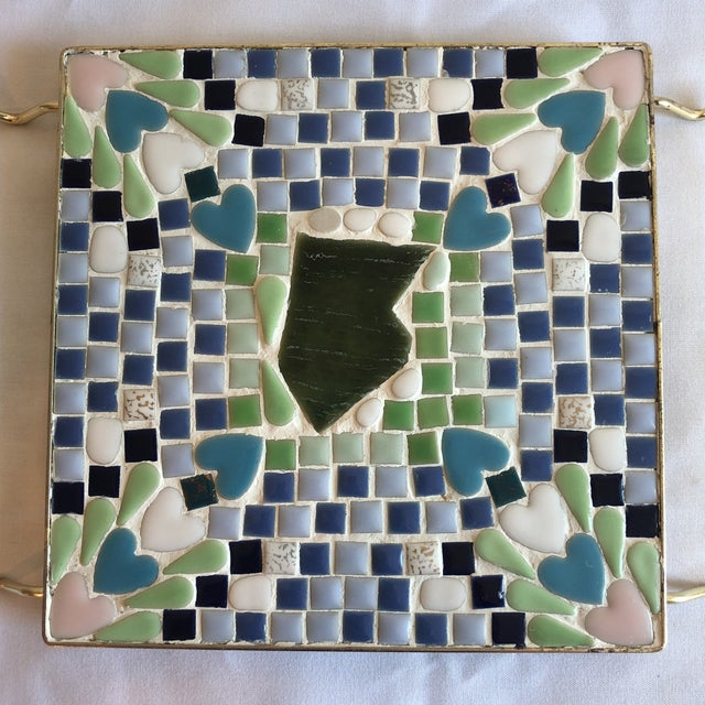 Retro mosaic trivet with brass plated handles.
