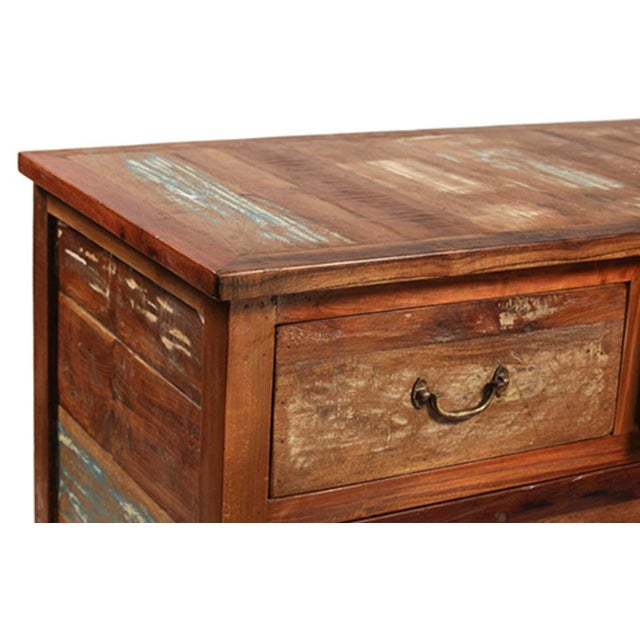 Reclaimed wood spacious nine drawer dresser. Old wood with aged paint and distressed character. Iron handles. Finished in...