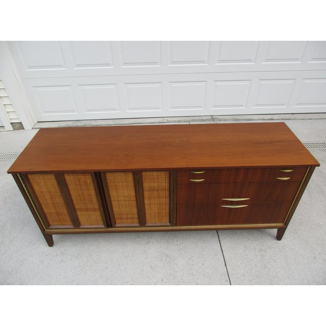 Mid Century Walnut Triple Dresser with Reversible Cane Side Panels For Sale - Image 6 of 11